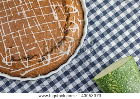 Sweet Gingerbread Zucchini Pie With Lemon Topping On Blue Checkered Placemats