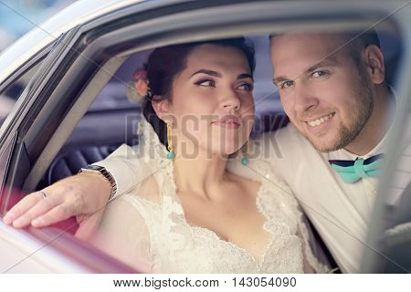 Wedding Couple Is Hugging In A Car. Beauty Bride With Groom. Beautiful Model Girl In White Dress. Ma