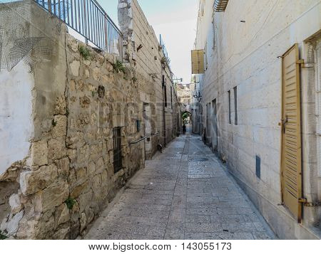 The narrow stone street in the Old City of Jerusalem Israel