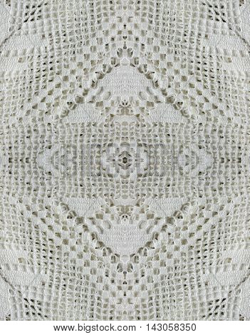 White organic cotton crochet pattern lace background backdrop for scrapbook top view. Collage with mirror reflection. Mysterious backdrop. Seamless pattern kaleidoscope montage