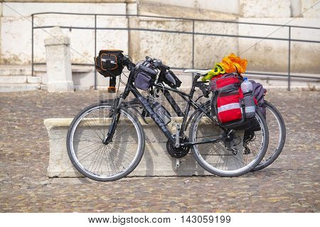 MANTUA, ITALY - JULY, 23, 2016: tourist bike on a square infront of Ducal Palace in Mantua, Italy