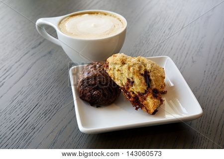 Scones on a plate with a latte