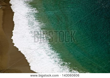 Close up of a wave rolling into shore.