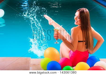 Happy Woman With Balloons And Cocktail At Poolside