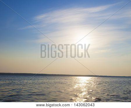 Sun rising over a lake in Northern Saskatchewan Canada