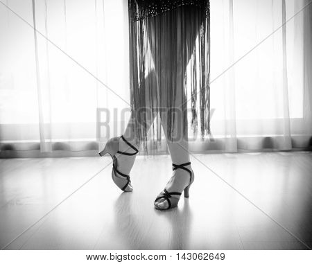 Woman dancing latin rhythms. Black and white