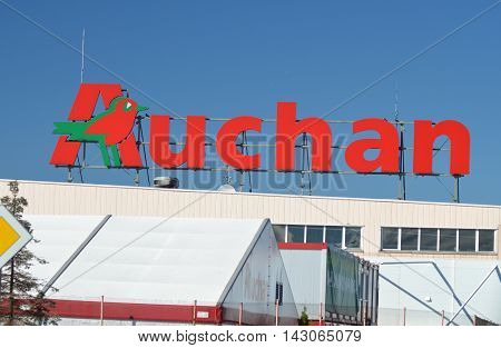 CIRCA AUGUST 2016 - GDANSK: logo of Auchan against blue sky. Groupe Auchan SA is French international retail group and multinational corporation headquartered in Croix, France. It was founded in 1961.
