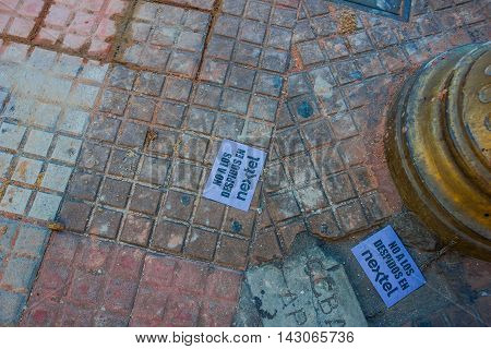 BUENOS AIRES, ARGENTINA - MAY 02, 2016: small papers with some protest message against a phone company.