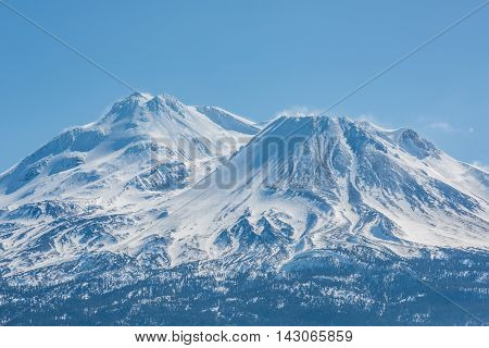 Snowcapped Mount Shasta volcano during winter blue closeup