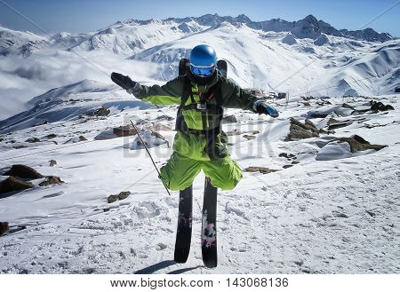 Mountain freeride skier standing on ski noses with Himalayas peaks on background
