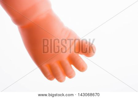 Baby doll's legs on a white background