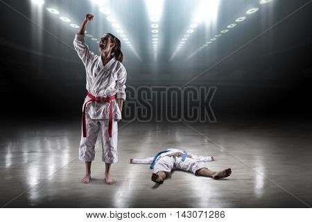 Sexy Girl In A Kimono Karate Rejoices Victory