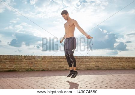 Young Man Jump Jumping Rope Fit Slim Abs Model
