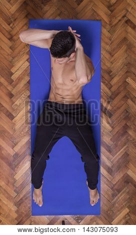 Young Fit Slim Muscular Sideway Abs Man Exercise Elevated View