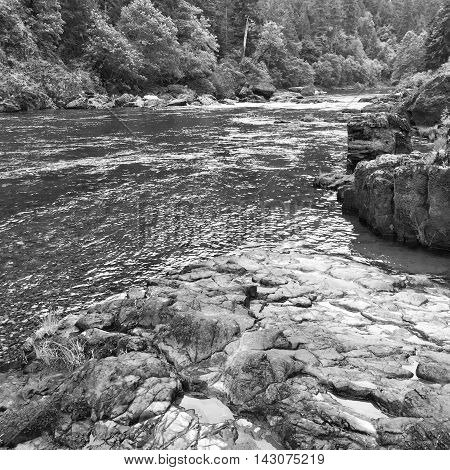 The Umpqua River in Oregon spends millennia carving through the lava rock.