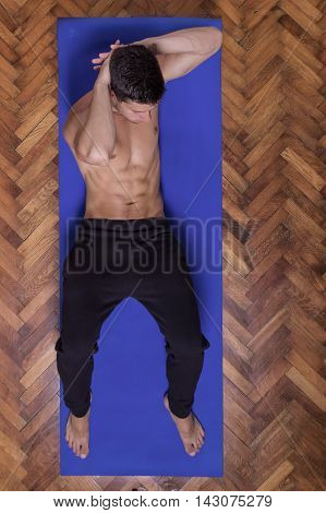 Young Man Abs Workout Sideway Elevated View