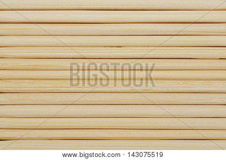 Horizontal bamboo toothpicks line up in row