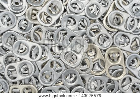 Close-up and detail of aluminum can ring pull background