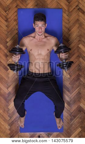 Young Man Dumbell Chest Elevated View