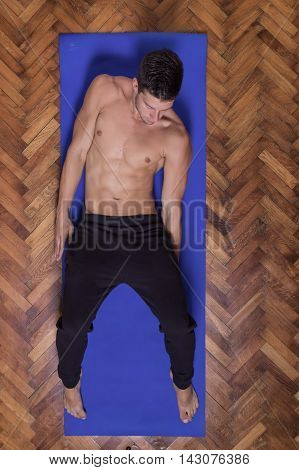 Young Man Fit Slim Body Abs Sideways Shirtless Elevated View