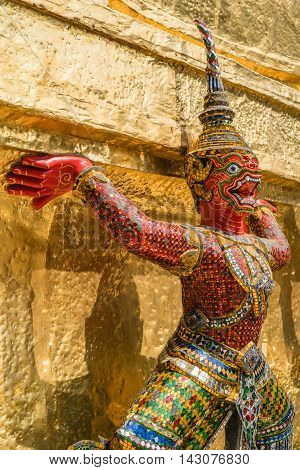 BANGKOK THAILAND - MARCH 9 2016: Thai colorful giant statue around Golden Chedi at Wat Phra Kaew in Bangkok Thailand.