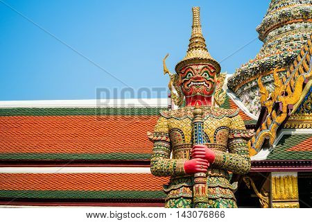 BANGKOK THAILAND - MARCH 9 2016: The red giant demon guarding an exit to Grand Palace at Wat Phra Kaew in Bangkok Thailand.