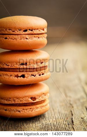 three different kind of macarons on a table