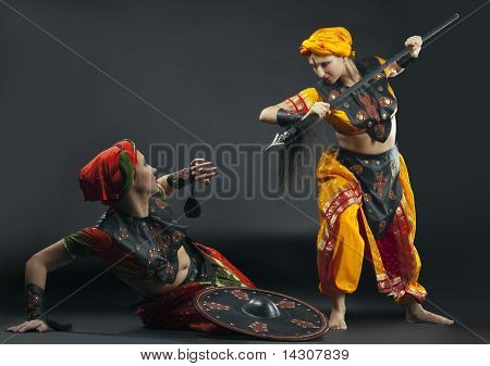 Two woman fight with spear and shield
