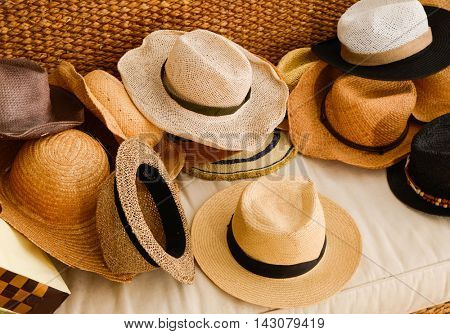 Stacked of many woman hat in sofa