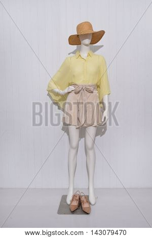 Full length female clothing with hat ,shoe on mannequin