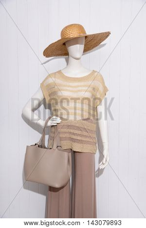 female dress with hat ,bag on dummy