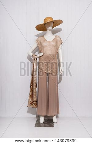 Full length female dress with hat ,scarf on dummy