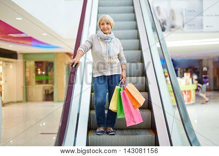 Shopper on escalator