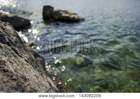 Mountain lake with shimmering clear blue-green water