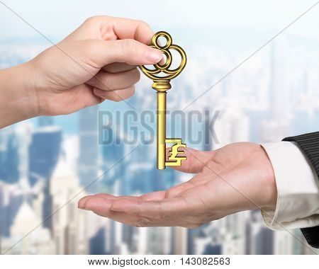 Woman Hand Giving Pound Sign Treasure Key To Man Hand