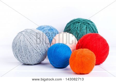 colorful Natural woolen yarn. white background.selective focus