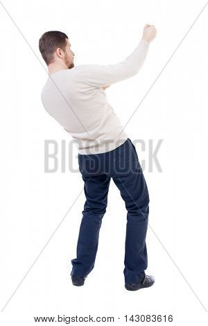 back view of standing man pulling a rope from the top or cling to something.  Rear view people collection.  backside view of person.  Isolated over white background.  The bearded man in a white warm