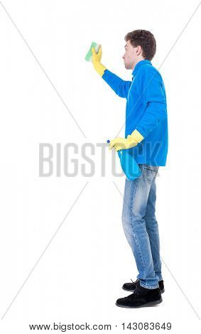 side view of a cleaner man in gloves with sponge and detergent. girl  watching.  view of person.  Isolated over white background. Curly boy in a blue sweater in the process of cleaning ..