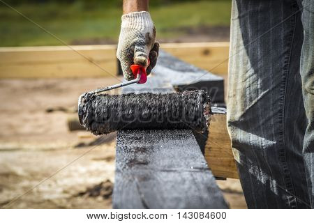 Coating the surface of the wooden beams roller protective layer
