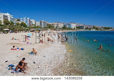 ATHENS, GREECE - AUGUST 16, 2016: People on the beach in Palaio Faliro in Athens, Greece on August 16, 2016.