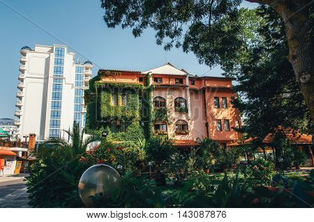 View of the pink building covered with greenery in Sunny Beach Bulgaria.
