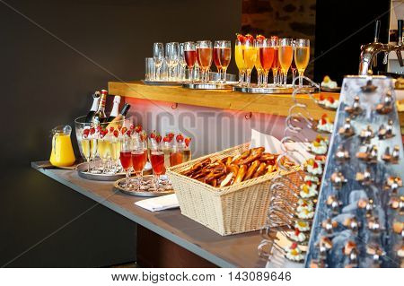 Table in the yard full of different finger food ready for the party. Wedding, birthday, engagement