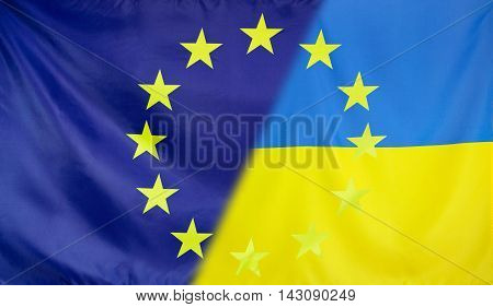 Ukraine and European Union relations concept with diagonally merged flags
