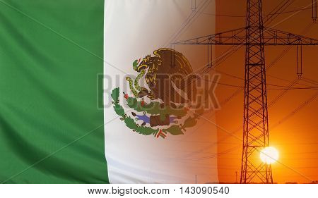 Concept Energy Distribution Flag of Mexico with high voltage power pole during sunset