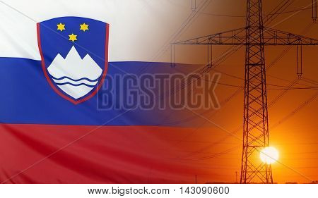 Concept Energy Distribution Flag of Slovenia with high voltage power pole during sunset