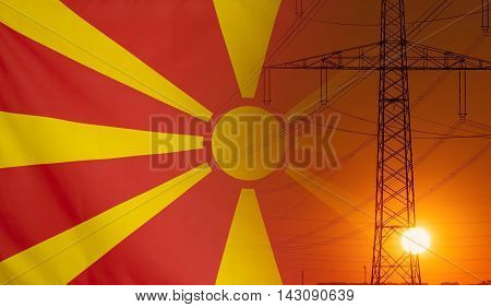 Concept Energy Distribution Flag of Macedonia with high voltage power pole during sunset