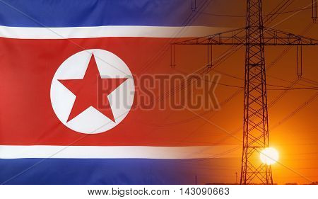 Concept Energy Distribution Flag of North Korea with high voltage power pole during sunset