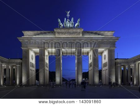 Brandenburg Gate Berlin and the Quadriga on top of the gate twilight transition to night