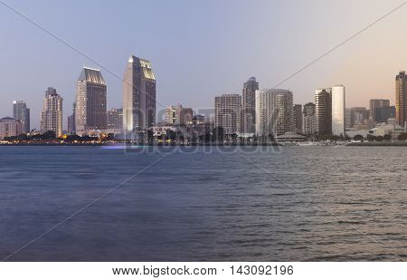 San Diego skyline sunset and twilight transition with waterfront of the pacific ocean