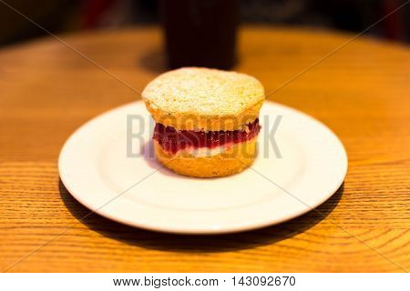 Selected focus on strawberry jam English scone on the table